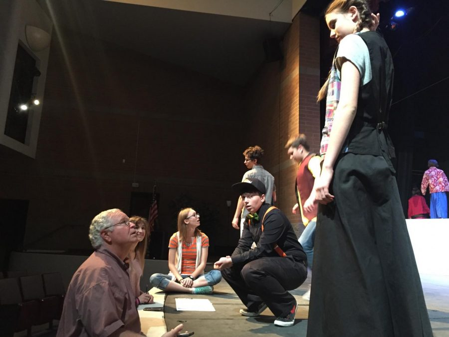 Theatre+teacher+and+director%2C+Mr.+Abaroa%2C+gives+cast+comments+and+pointers+to+prepare+them+for+the+show