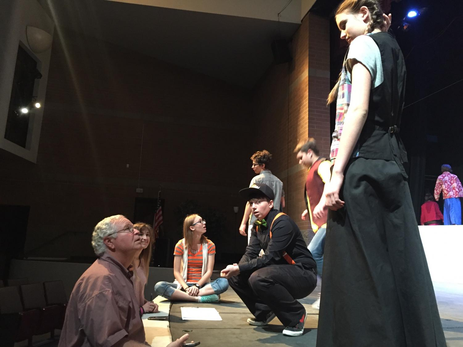 Theatre teacher and director, Mr. Abaroa, gives cast comments and pointers to prepare them for the show