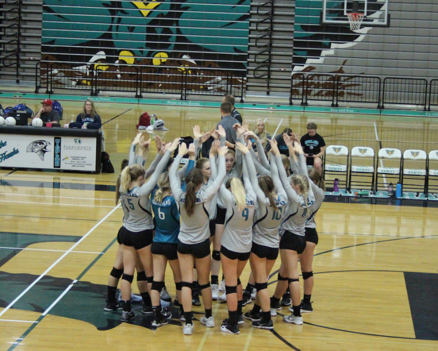 The Varsity Volleyball girls huddle before the match on September 19, 2017 at HHS.