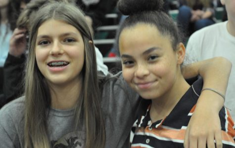 Freshmen Trista Siren (Left) and Olivia Richardson (Right) enjoying the winter pep assembly.