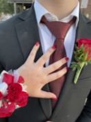 Showing off her corsage and date's boutonniere, Kiley Davern captured this moment to remember her first ever prom in high school.,