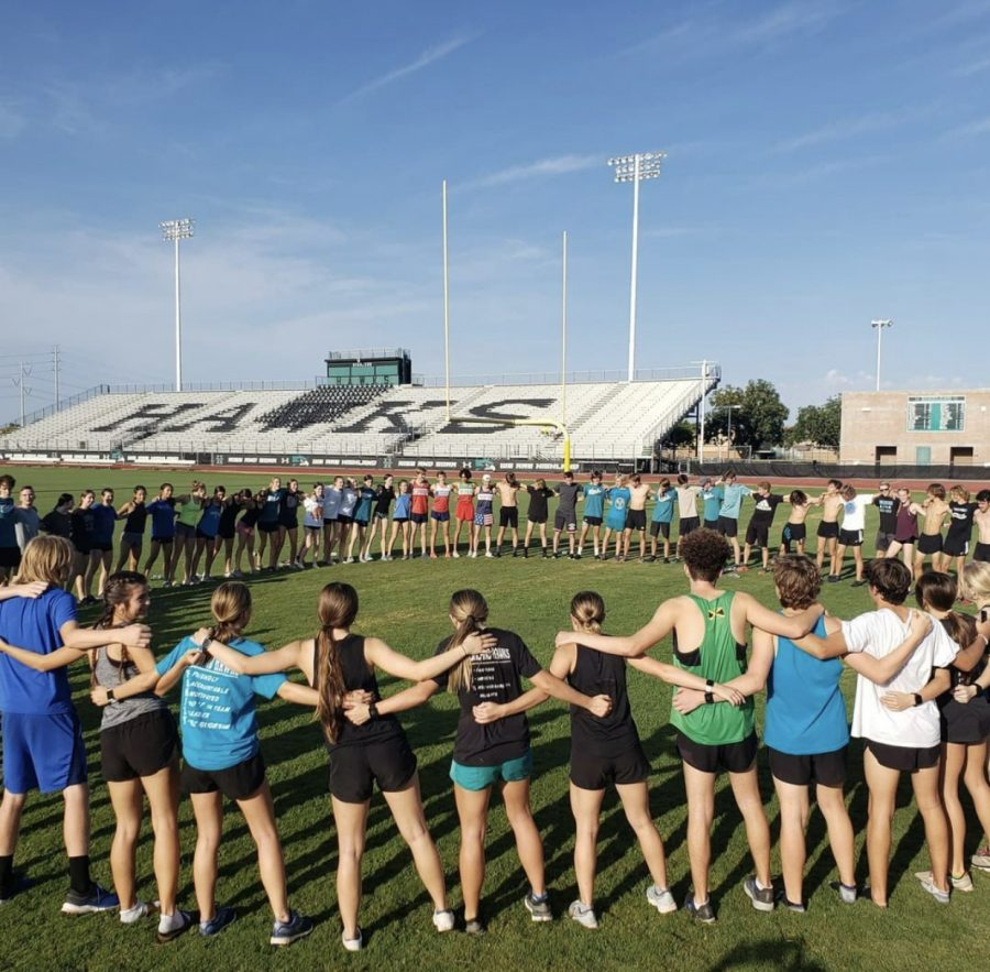 Photo Credit: David Montgomery Hawk cross country runners create close bonds with each other.